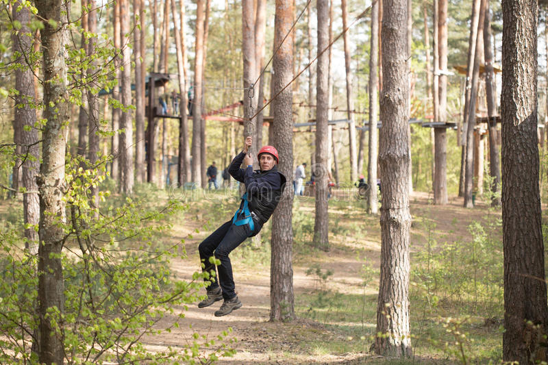 Gomel, Belarus - 30 April, 2017: Rope town for a family holiday in the countryside. Family competition to overcome aerial obstacle. S royalty free stock photos