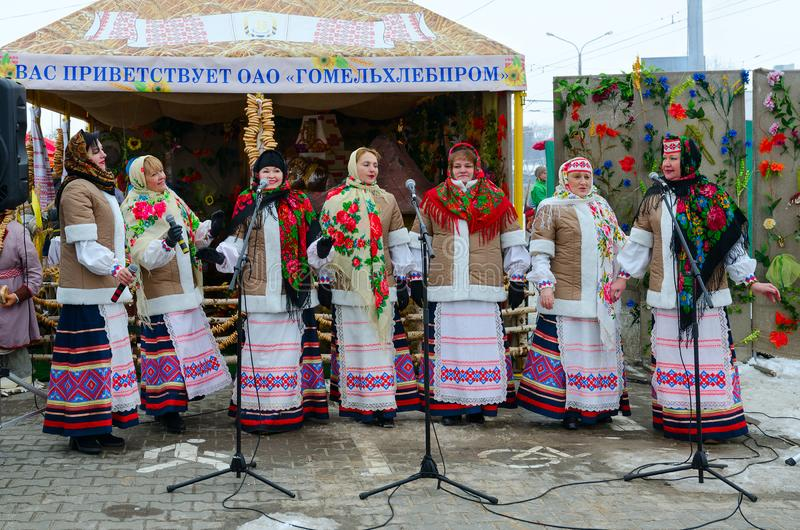 Performance of creative collective during Shrovetide festivities outdoors, Gomel, Belarus. GOMEL, BELARUS - FEBRUARY 18, 2018: Performance of creative collective royalty free stock images