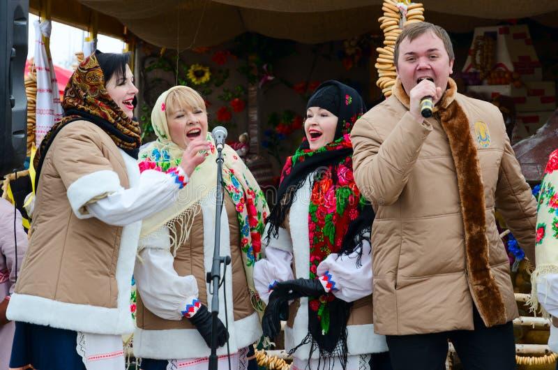 Performance of creative team during Shrovetide festivities, Gomel, Belarus. GOMEL, BELARUS - FEBRUARY 18, 2018: Performance of creative team during Shrovetide stock image