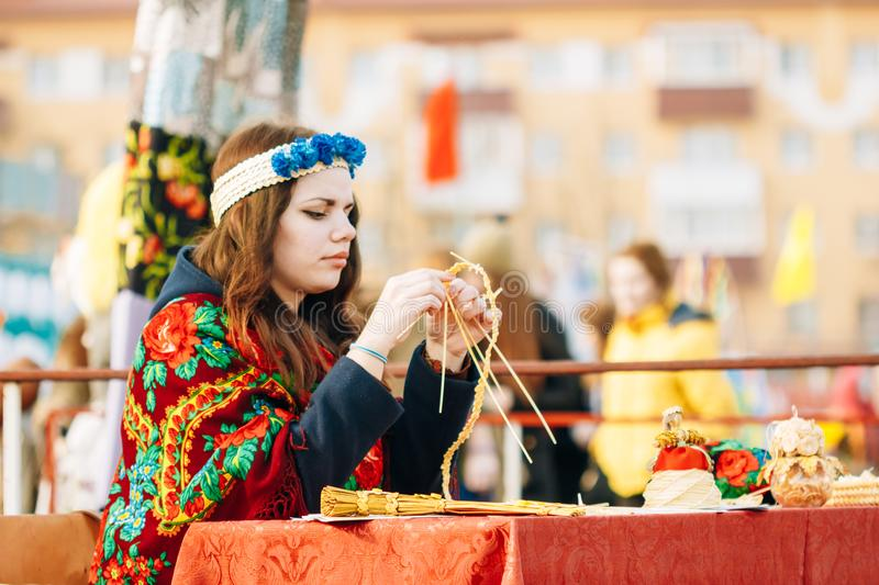 Girl in Belorussian national costume at the fair. Gomel, Belarus stock images