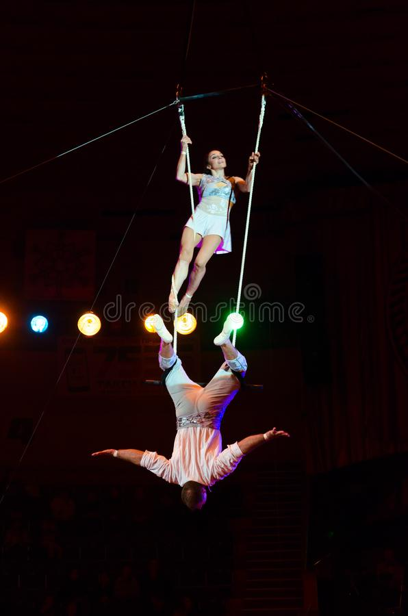 Tour of Moscow State Circus named after Nikulin. Duet on trapeze air gymnasts Victoria and Alexei Artemyev. GOMEL, BELARUS - MARCH 23, 2018: Tour of Moscow State stock photography