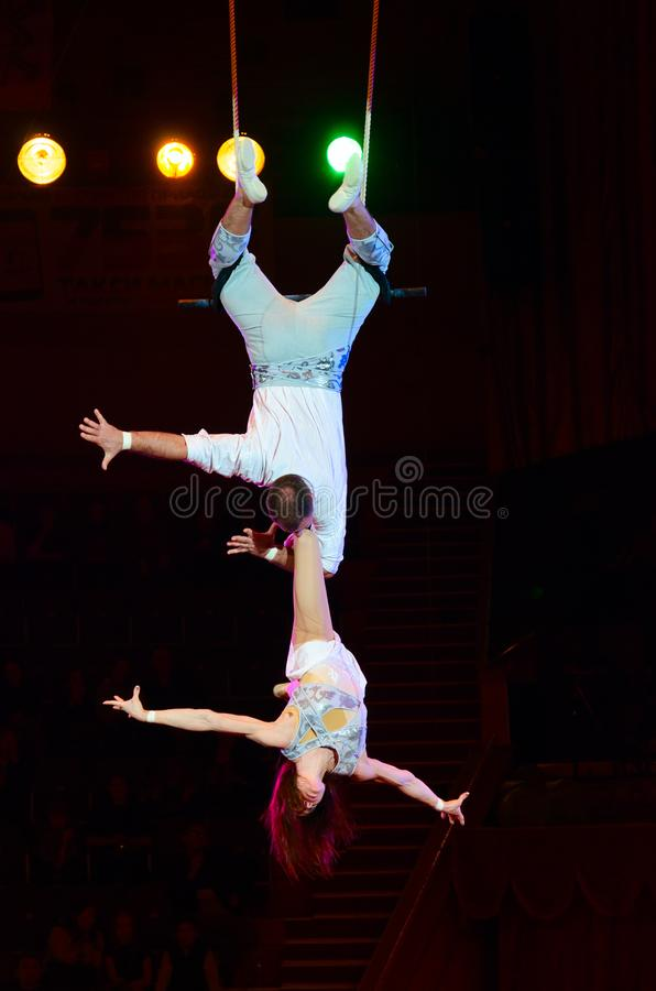 Tour of Moscow State Circus named after Nikulin. Duet on trapeze air gymnasts Victoria and Alexei Artemyev royalty free stock photos