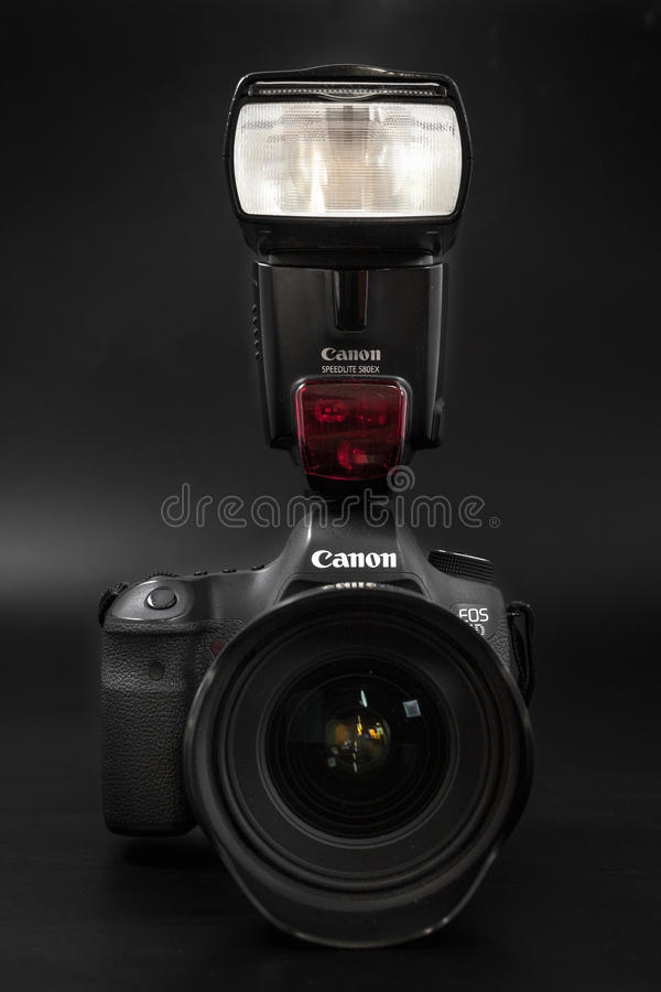 GOMEL, BELARUS - May 12, 2017: Canon 6d camera with lens on a black background. Canon is the world`s largest SLR camera manufactur. Er royalty free stock photography