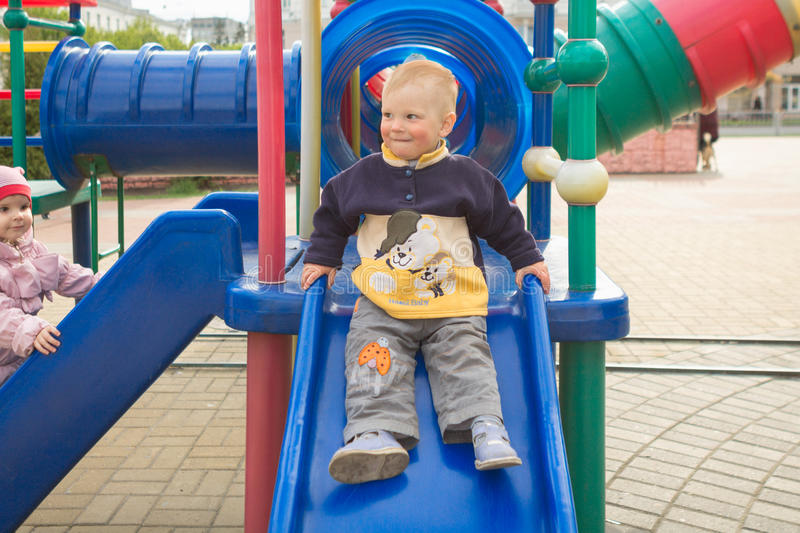 Gomel, Belarus - MAY 3, 2015: A child plays on a beautiful playground. royalty free stock image