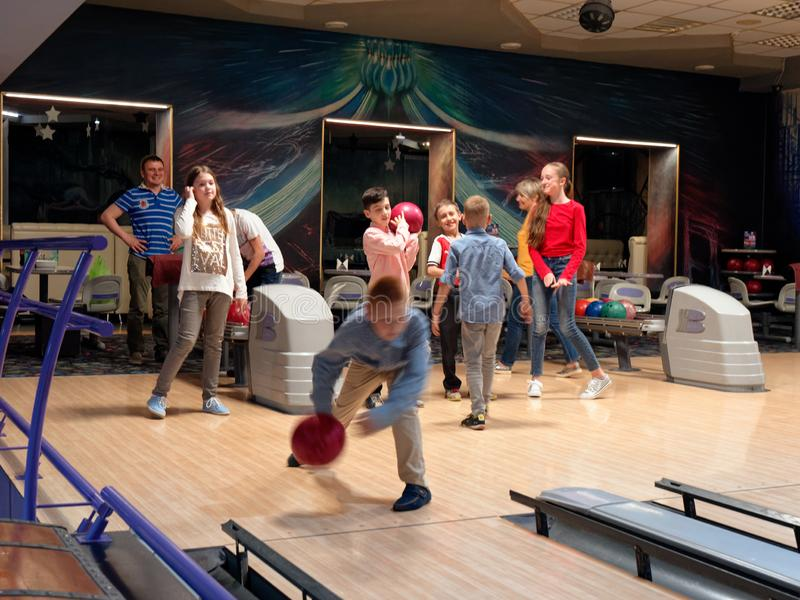 GOMEL, BELARUS - MAY 15, 2019: Continent Entertainment Center. Kids playing bowling. GOMEL, BELARUS - MAY 15, 2019: Continent Entertainment Center Kids playing royalty free stock image