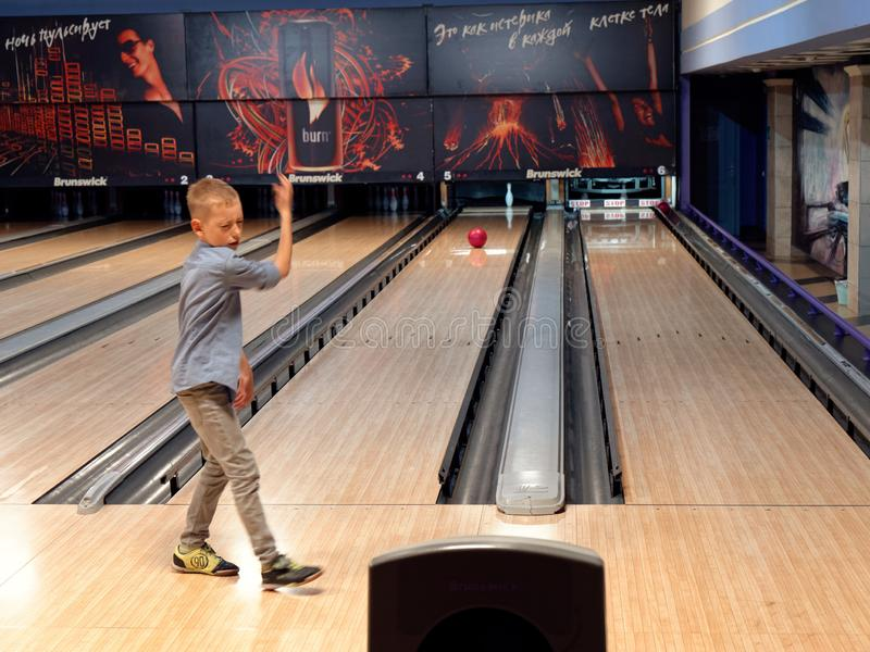 GOMEL, BELARUS - MAY 15, 2019: Continent Entertainment Center. Kids playing bowling. GOMEL, BELARUS - MAY 15, 2019: Continent Entertainment Center Kids playing stock image