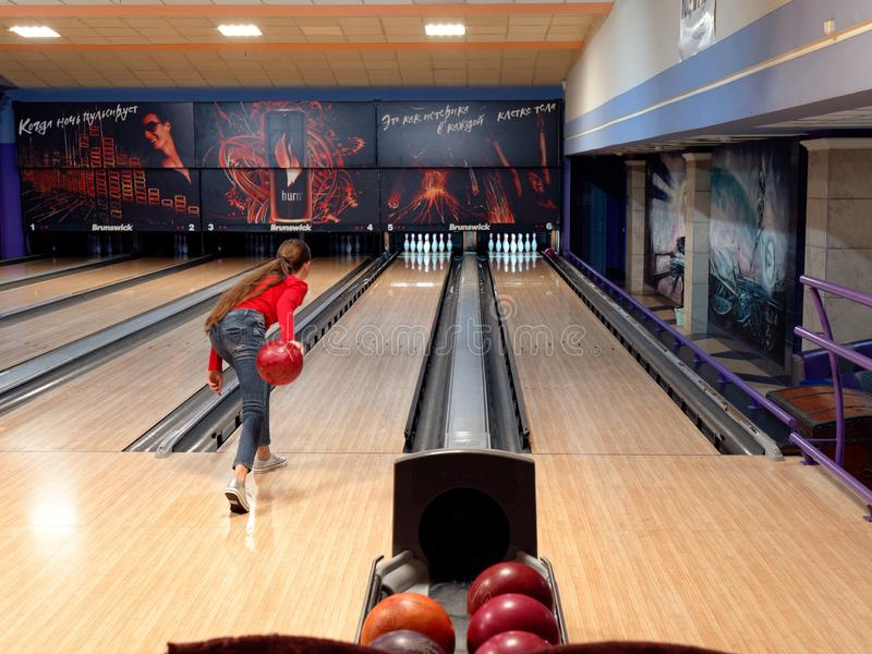GOMEL, BELARUS - MAY 15, 2019: Continent Entertainment Center. Kids playing bowling. GOMEL, BELARUS - MAY 15, 2019: Continent Entertainment Center Kids playing stock photos
