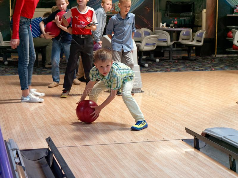 GOMEL, BELARUS - MAY 15, 2019: Continent Entertainment Center. Kids playing bowling. GOMEL, BELARUS - MAY 15, 2019: Continent Entertainment Center Kids playing royalty free stock photography