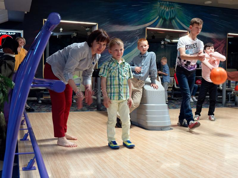GOMEL, BELARUS - MAY 15, 2019: Continent Entertainment Center. Kids playing bowling. GOMEL, BELARUS - MAY 15, 2019: Continent Entertainment Center Kids playing stock photography