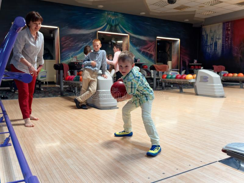 GOMEL, BELARUS - MAY 15, 2019: Continent Entertainment Center. Kids playing bowling. GOMEL, BELARUS - MAY 15, 2019: Continent Entertainment Center Kids playing stock images