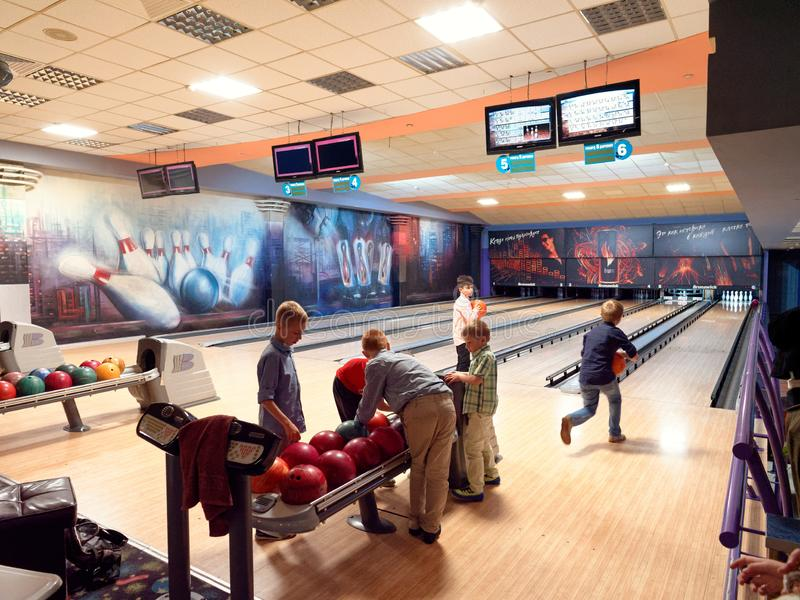 GOMEL, BELARUS - MAY 15, 2019: Continent Entertainment Center. Kids playing bowling. GOMEL, BELARUS - MAY 15, 2019: Continent Entertainment Center Kids playing royalty free stock photos