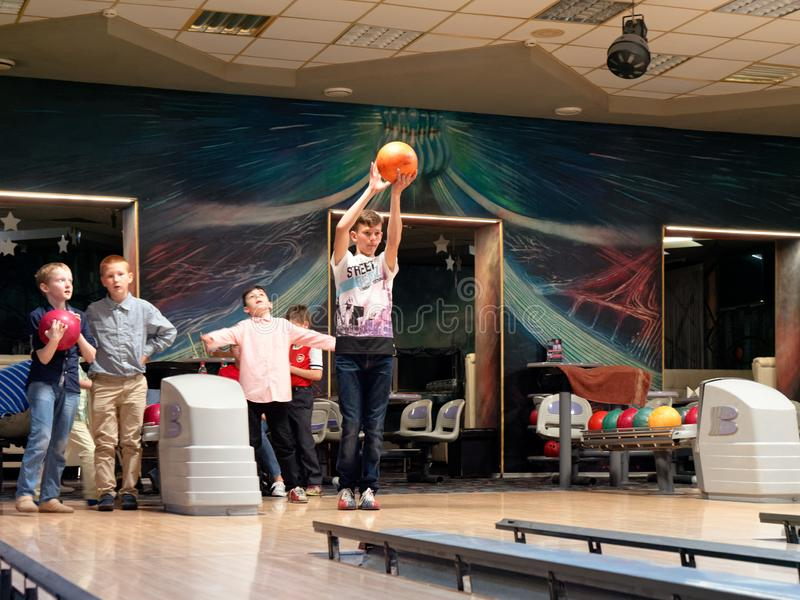 GOMEL, BELARUS - MAY 15, 2019: Continent Entertainment Center. Kids playing bowling. GOMEL, BELARUS - MAY 15, 2019: Continent Entertainment Center Kids playing stock photo