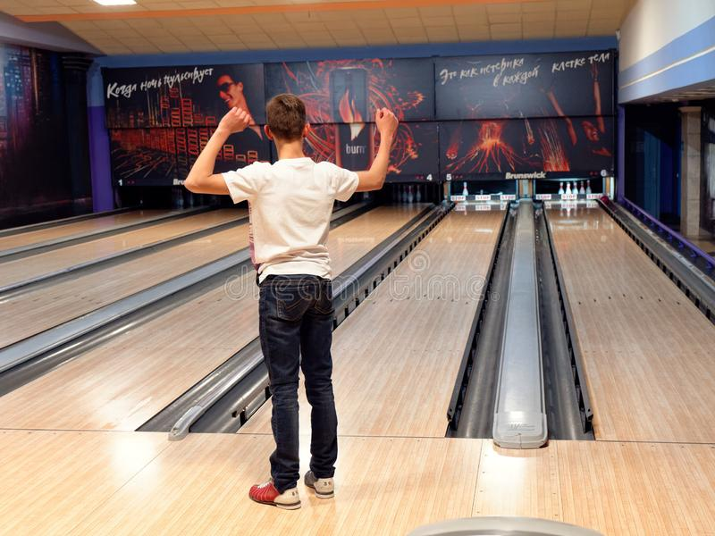 GOMEL, BELARUS - MAY 15, 2019: Continent Entertainment Center. Kids playing bowling. GOMEL, BELARUS - MAY 15, 2019: Continent Entertainment Center Kids playing royalty free stock photo