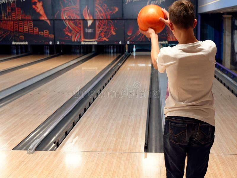 GOMEL, BELARUS - MAY 15, 2019: Continent Entertainment Center. Kids playing bowling. GOMEL, BELARUS - MAY 15, 2019: Continent Entertainment Center Kids playing royalty free stock images