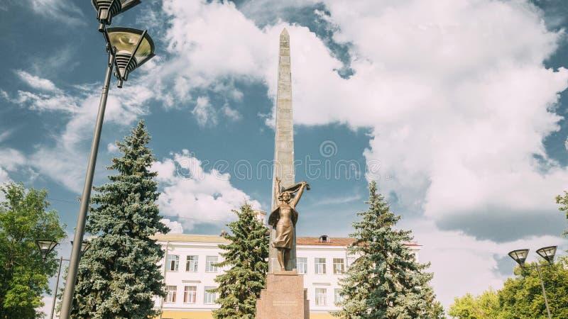 Gomel, Belarus. Monument To Heroes-members Of The Komsomol At Crossroads Of Streets Of Karpovicha And Zharkovskogo In. Gomel, Belarus. Hyperlapse Monument To stock images