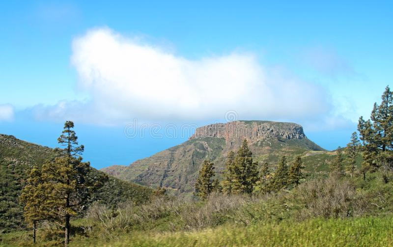 Gomera with its table mountain near the sea stock images