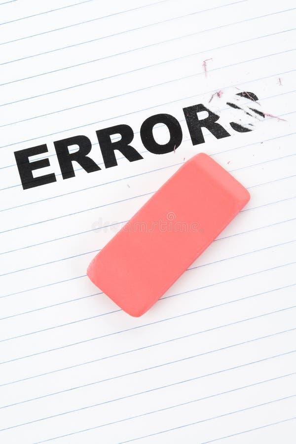 Gomme à effacer et erreur de mot image stock