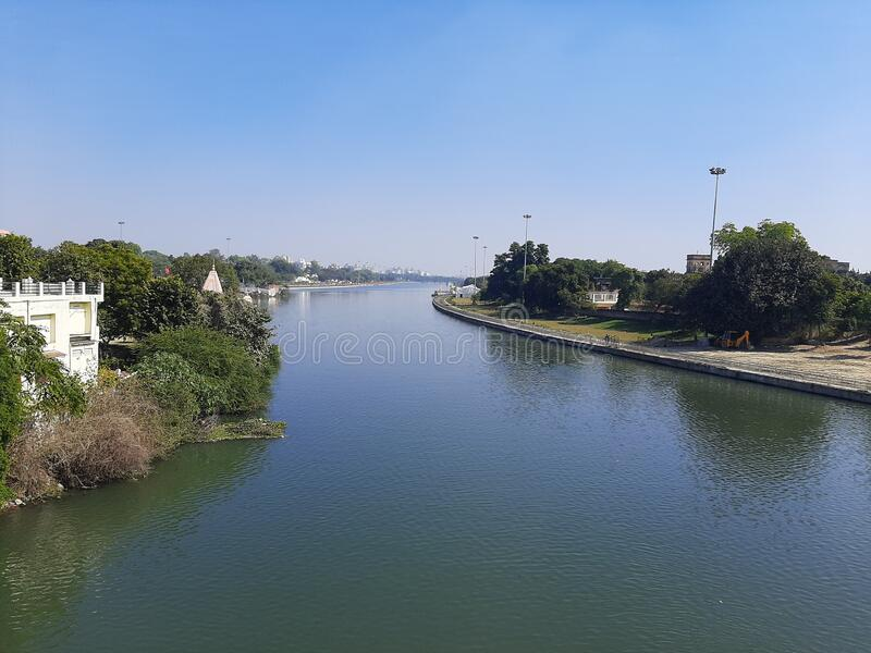 Gomti river at Lucknow india. View of gomti river at lucknow india and it`s banks , over view due to unplanned system of sewage water of city the river is highly stock photos
