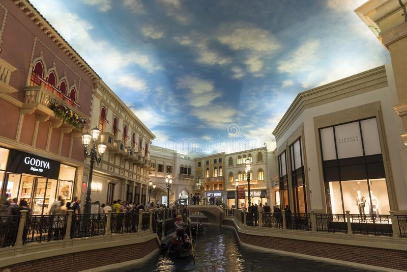 Gondola basin and shops in the Grand Shopping mall Venetian/Palazzo Las Vegas. The Palazzo /pəˈlɑːtsoʊ/ is a luxury hotel and casino resort stock image