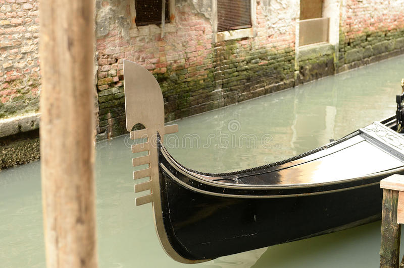 Gondola boat. Venice canal and part of a gondola boat passing by royalty free stock photo