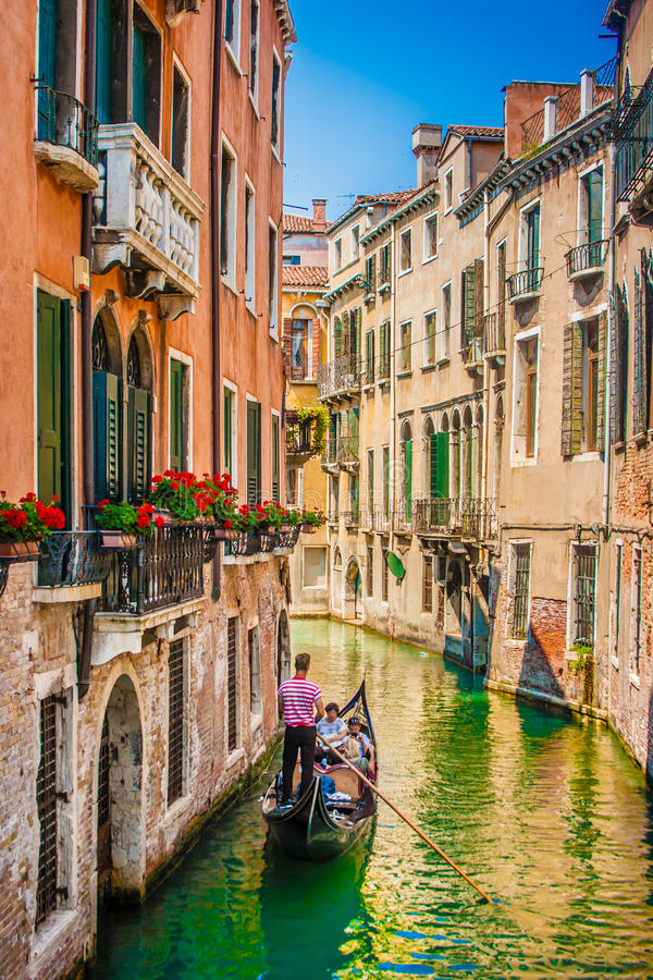 Gondola on canal in Venice, Italy. Beautiful scene with traditional gondola and canal in Venice, Italy stock image