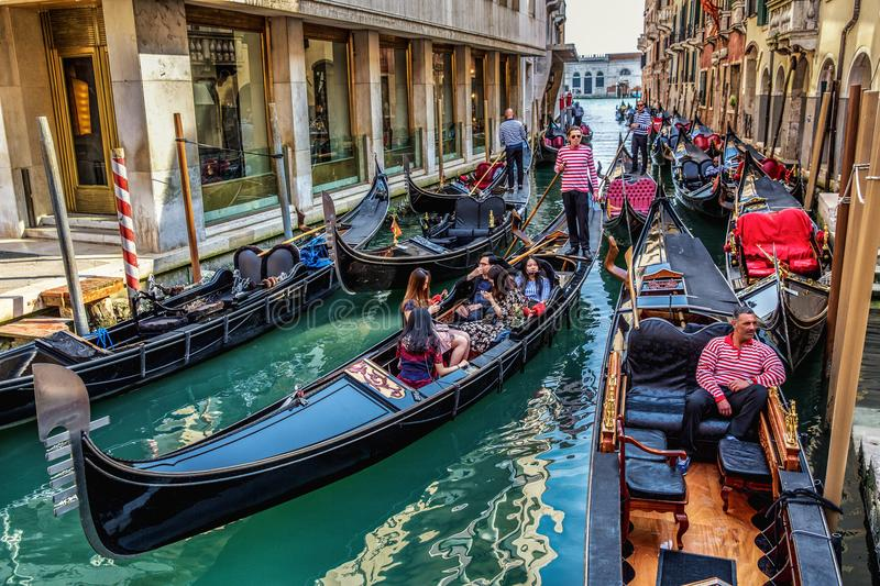 Gondola on canals in venice stock photo