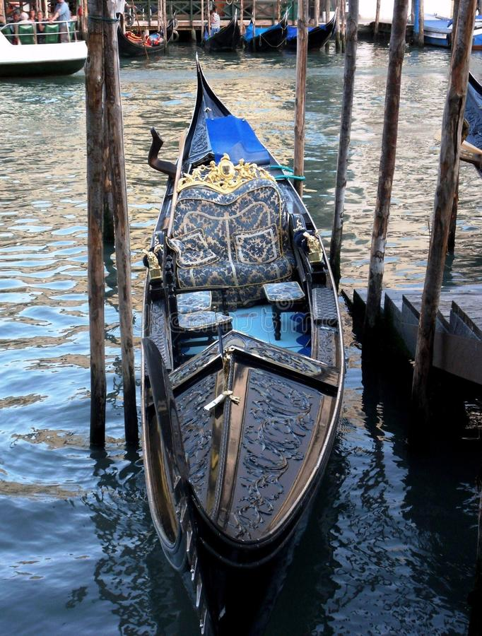 Gondola crooked. Venice, Veneto, Italy - June 1, 2014: the typical boat of the lagoon of Venice with a characteristic asymmetric shape, with wider left side of stock image