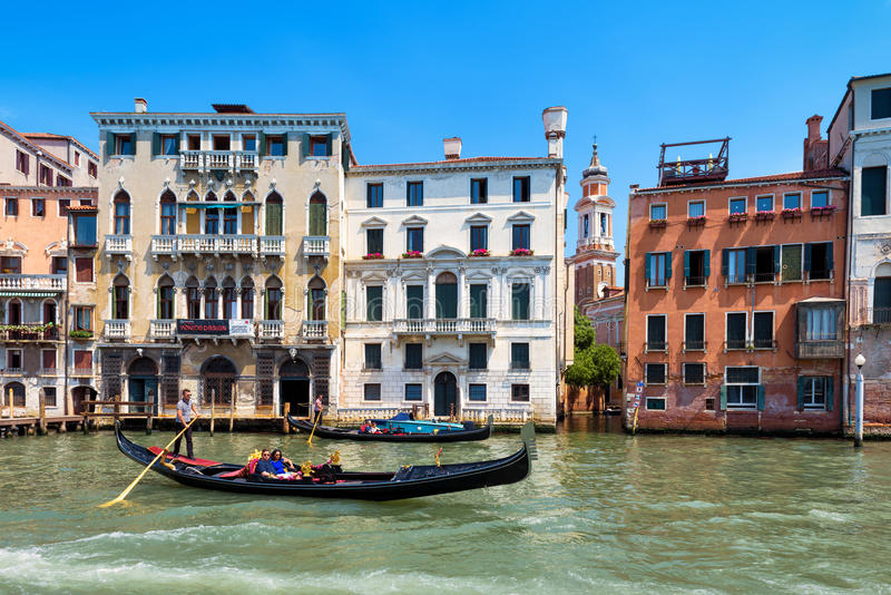Gondola floats along the Grand Canal in Venice stock photo