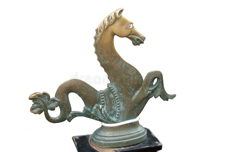 Gondola Horse. This ornamental bronze oarlock on a Venetian gondola is a traditional detail. This image has been isolated to a white background stock image