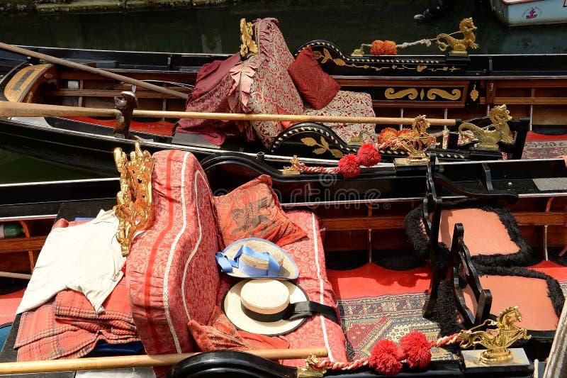 Gondola interiors in Venice, Italy. Interior seat with hats of ornate gondola boats in Venice, Italy stock photography