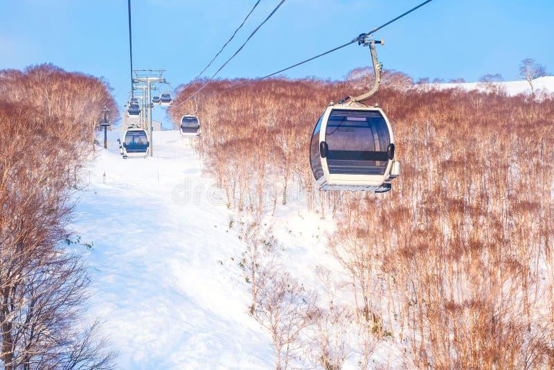 Gondola lift. The cable car transportation rope way at ski resort in winter season royalty free stock photography