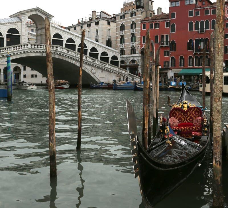 gondola moored on the Grand Canal near the Rialto Bridge in Veni stock image