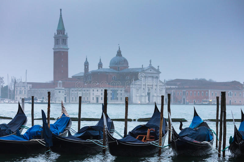 Gondola pier in Venice. Cold and misty Venetian morning royalty free stock photos