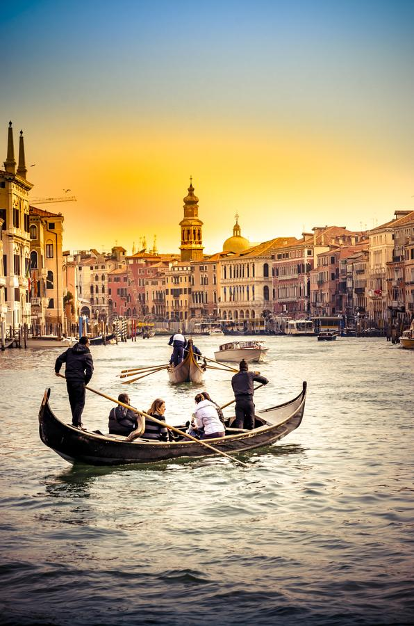 Gondola at the Rialto bridge with sunset light in Venice royalty free stock photo