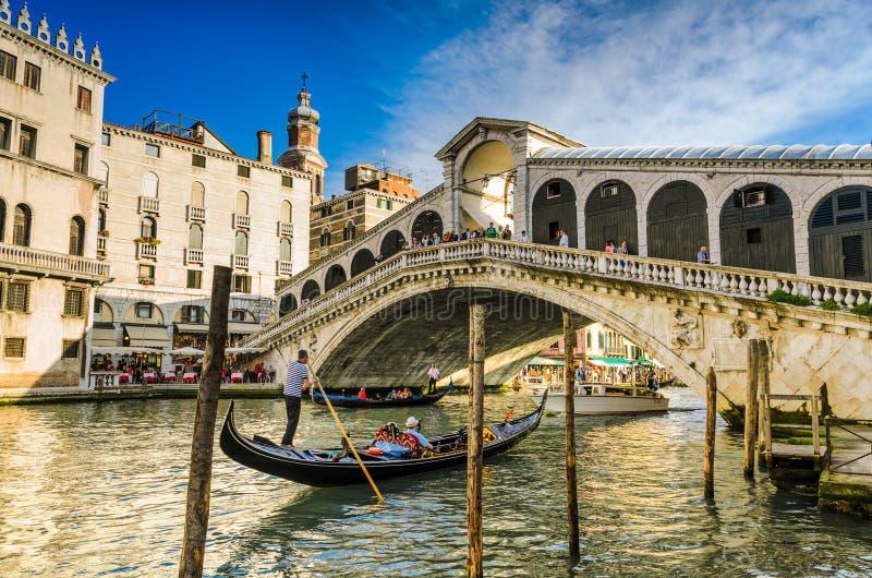 Gondola at the Rialto bridge in Venice, Italy stock images