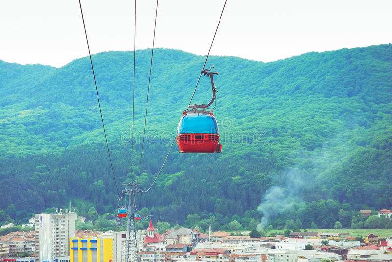 Gondola Ropeway. Above city with mountains in the back royalty free stock image