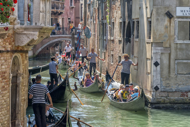 Gondolas in Venice, Italy. Gondolas in july 2015 in the crowded canals near San Marco piazza in Venice, Italy stock photography