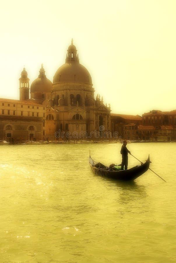 Gondola and Santa Maria della Salute basilica. stock photography