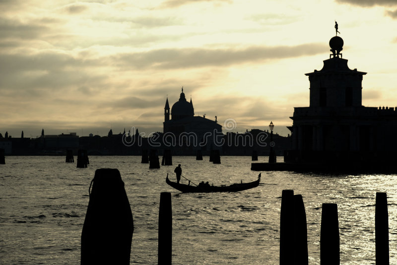 Gondola in the sunset. From piazza San Marco in backlight with high contrast - Venice (Italy stock image