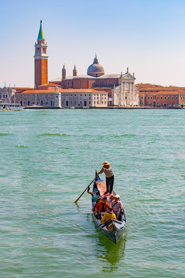 Gondola with the tourist in Venice, Italy royalty free stock images