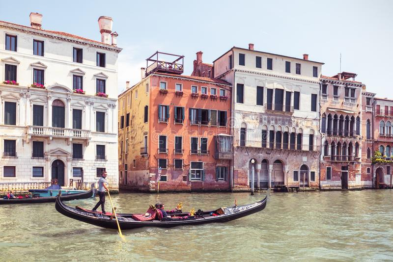 Gondola with tourists sails on Grand Canal, Venice royalty free stock photos