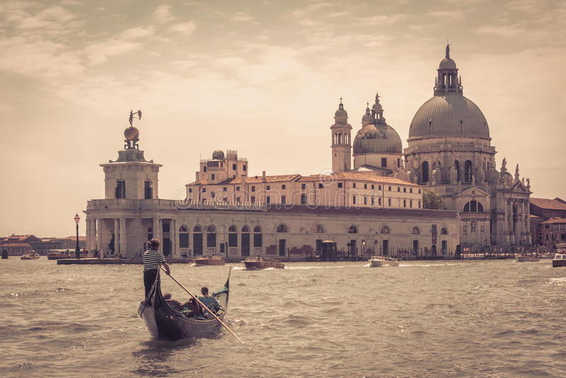 The gondola with tourists in Venice royalty free stock photography