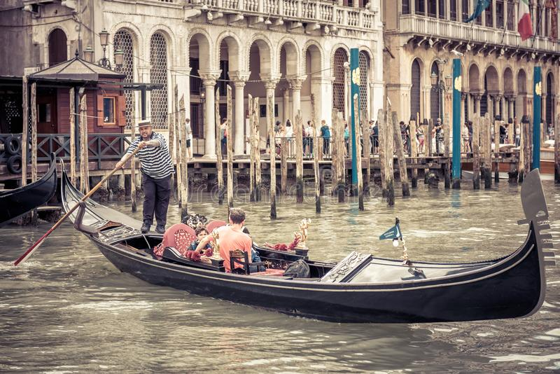 Gondola with tourists in Venice, Italy royalty free stock photo