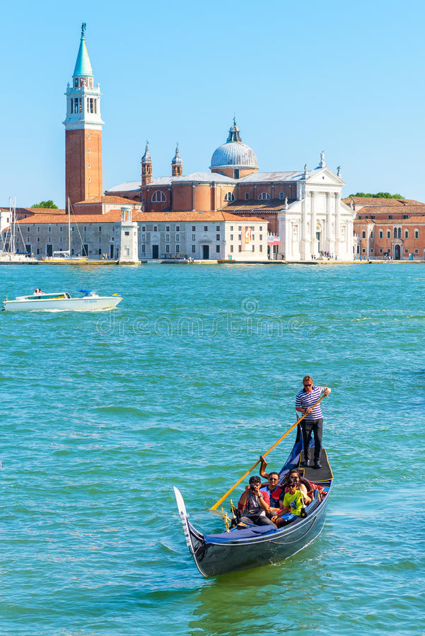 The gondola with tourists in Venice stock image