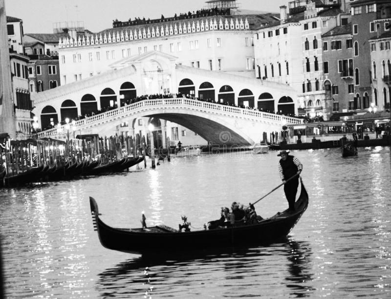 Gondola trip,at night, on the Grand Canal in Venice. Gondola trip, at night, on the  Grand Canal in Venice with a view on the Rialto bridge stock images