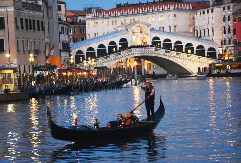 Gondola trip,at night, on the Grand Canal in Venice stock photo