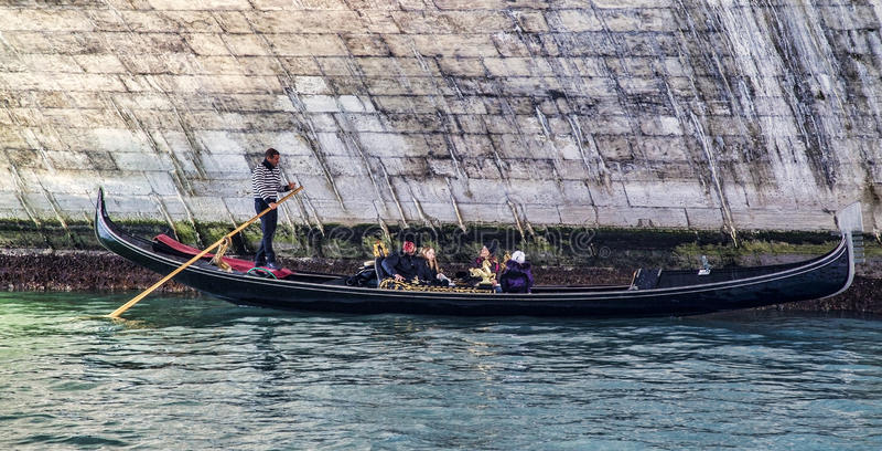 Gondola Under the Rialto Bridge royalty free stock image