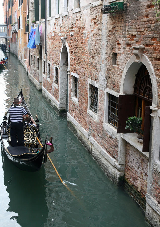 Gondola on the water channel. Gondola cruise on the water channel of Venice and the sailor stock images