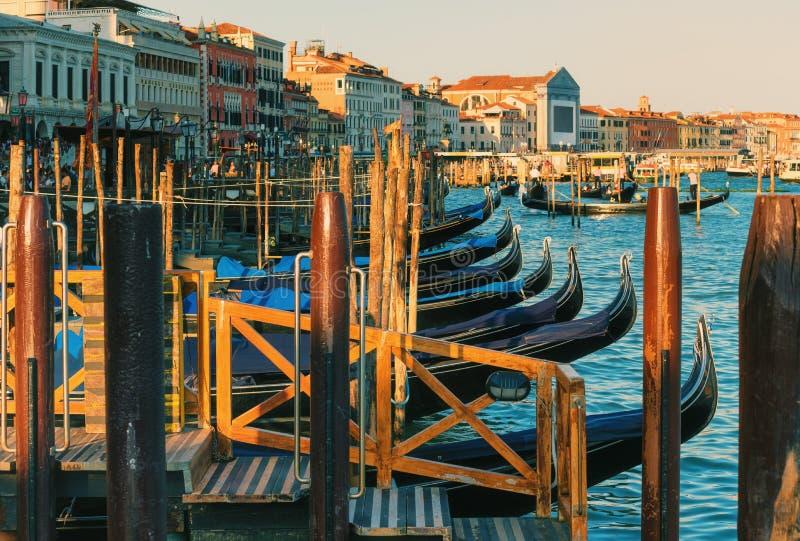 Gondolas along the banks of Grand Canal, Venice, Italy royalty free stock photo