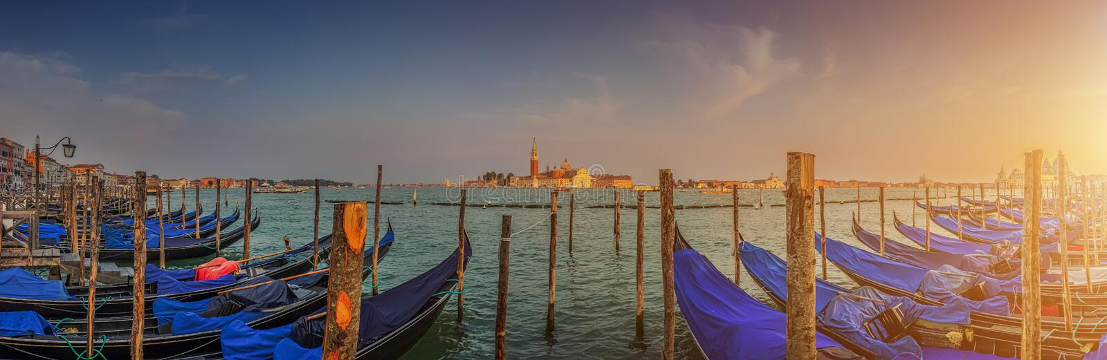 Gondolas on Canal Grande at sunset, San Marco, Venice, Italy royalty free stock image
